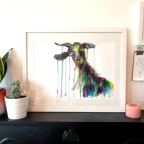 framed colourfully painted goat print