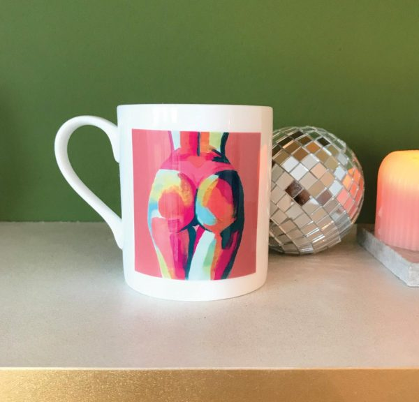 Peach and teal butt painting on a china mug