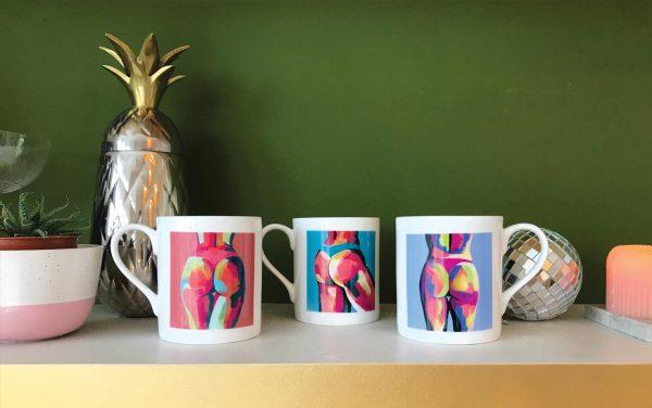 three colourful china butt mugs