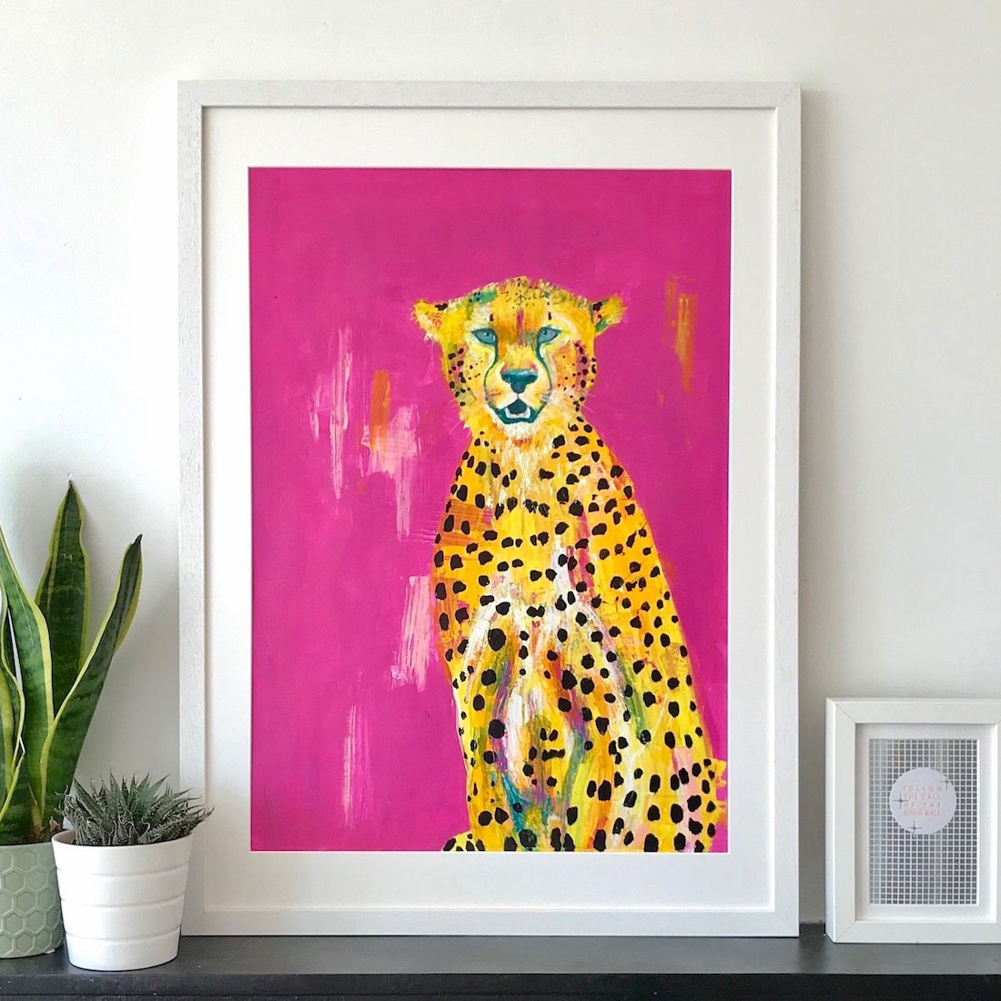 painting of cheetah on bright pink background