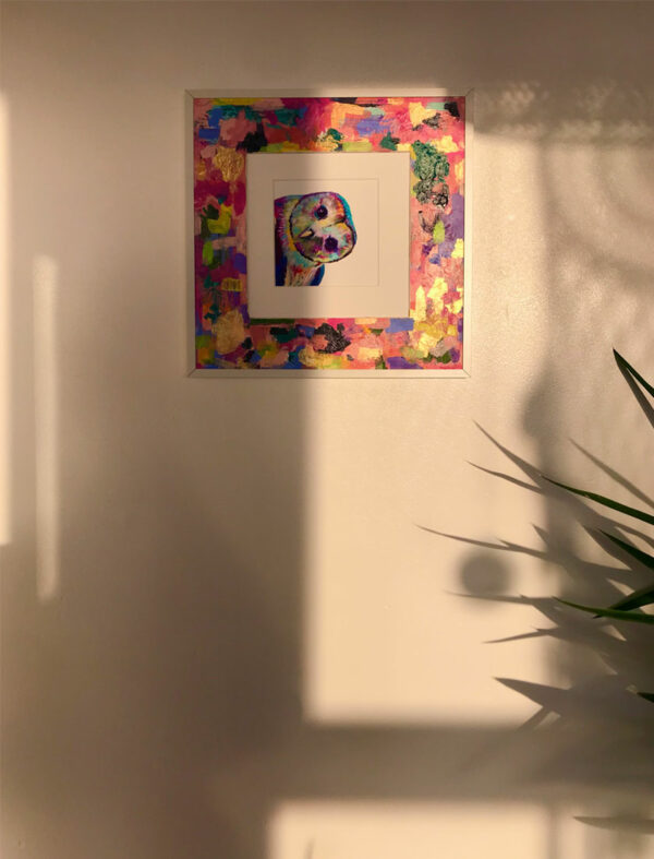 colourful owl framed in colourful mount in white frame with shadows over