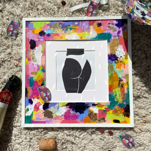 Black sparly paper cut butt in a bright mount with disco ball and gold bottle