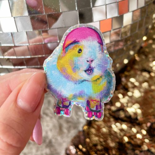 Holohraphic glitter sticker with roller skating guinea pig on a disco ball and sequin back ground